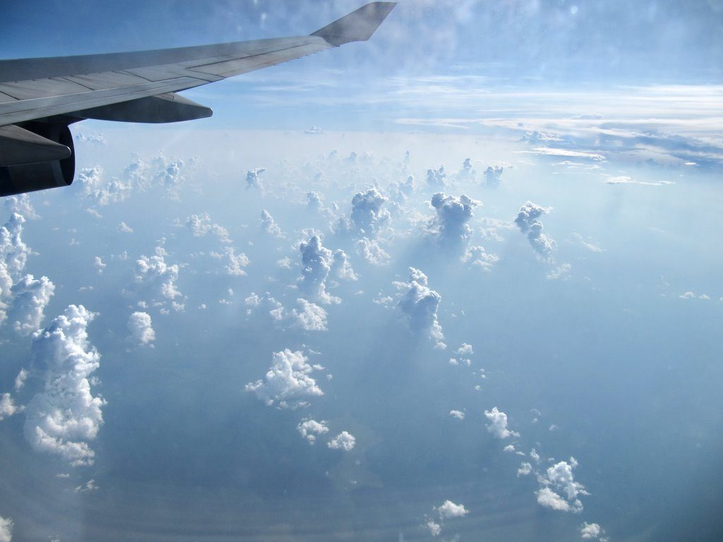 photo of clouds taken from an airplane window