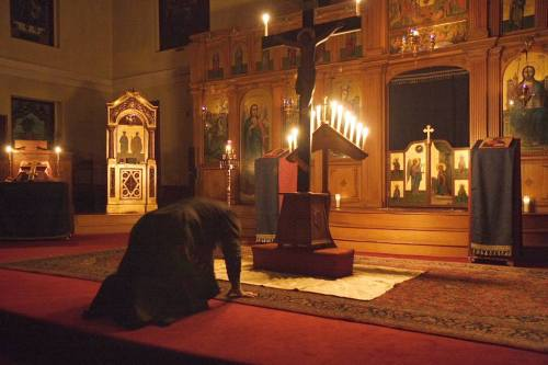 Photo of a priest praying in a church