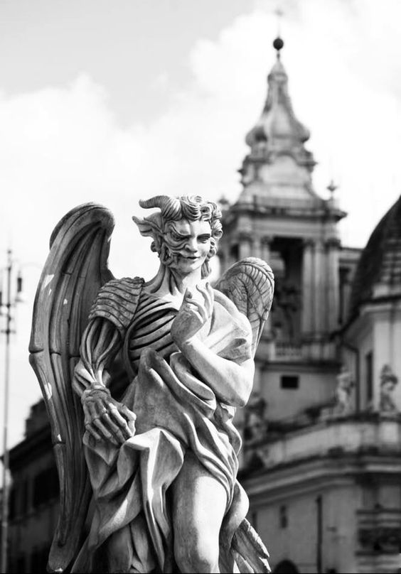 Statue of half demon half angel being