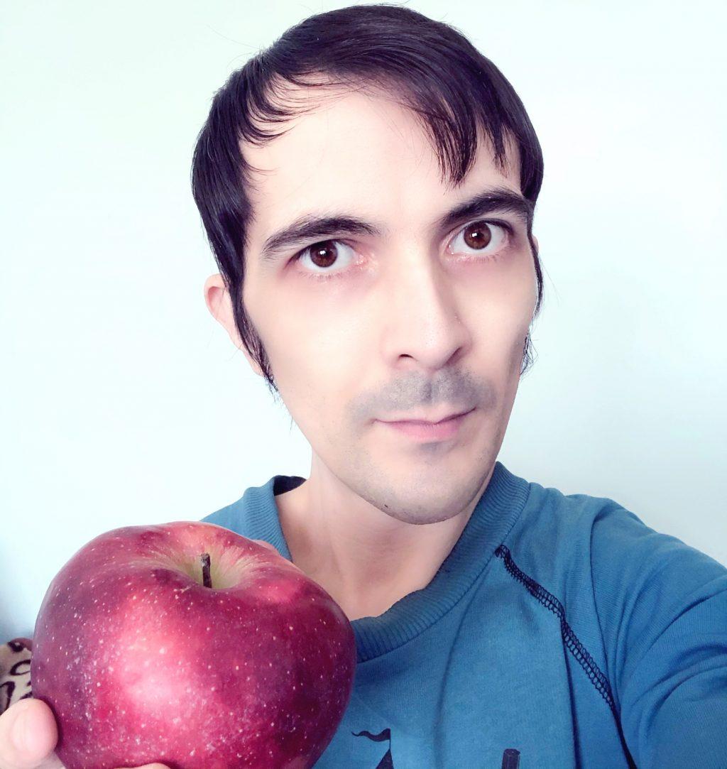 Selfie holding red apple